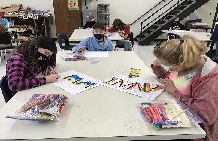 Middle school students in art class
